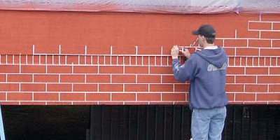 Whether you're working on a decorative wall in a backyard or the exterior walls of a 15-story building, consider stencils for vertical surfaces.