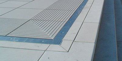 Metal grates can be made from galvanized steel, stainless steel, iron or brass. Because of this, and because of the wide range of material and load class ratings, metal grates vary widely in cost.