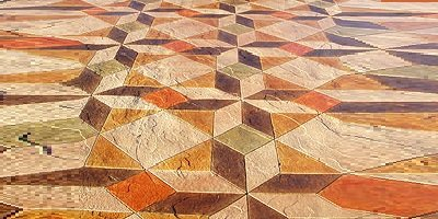 Acrylic stains for concrete often replace acids -- but even more intriguingly, the two can work together. Orange, Brown, Green and tan acrylic concrete stain in a geometric textured pattern.