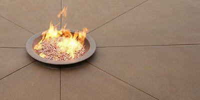 Fire pit in the middle of a concrete slab.