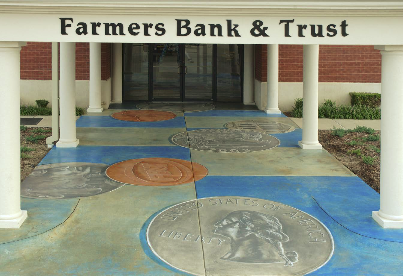 Bank entrance that has been stained with images of coins.