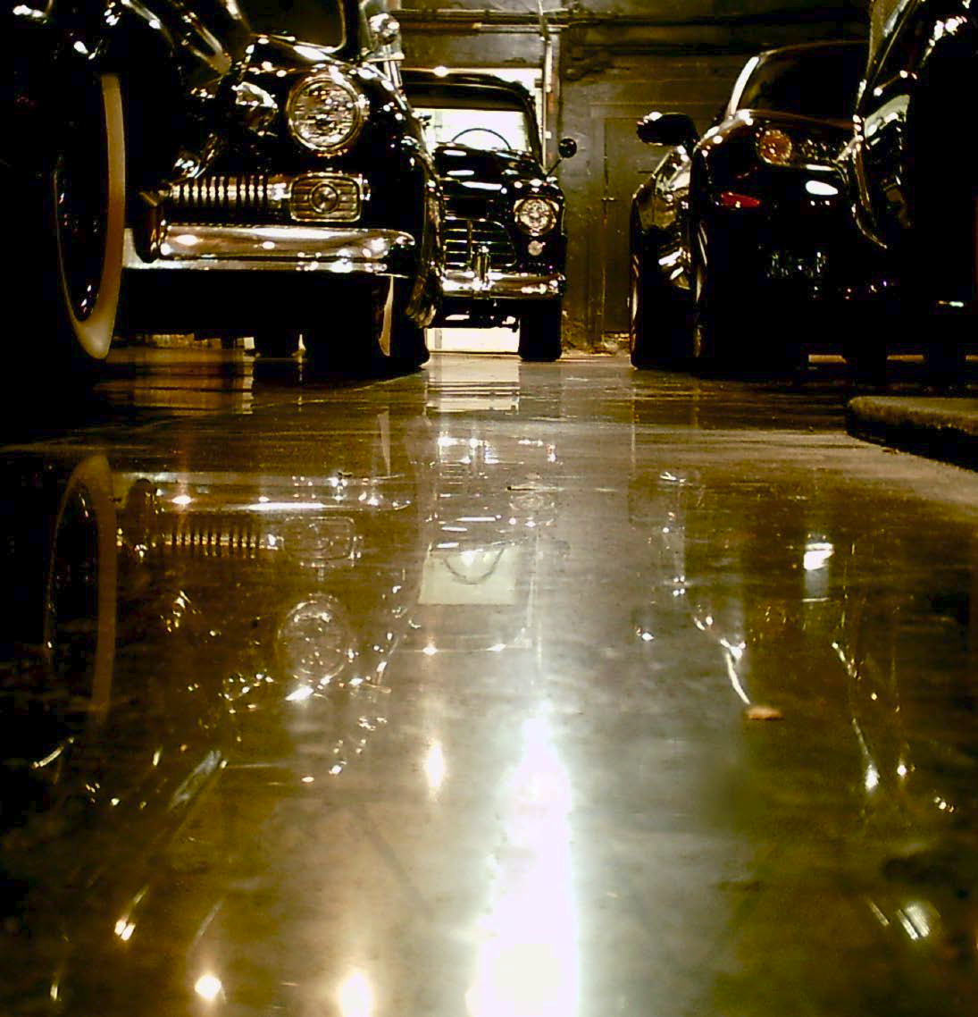 The floor of this garage has a highly reflective floor achieved with a concrete polishing machine.