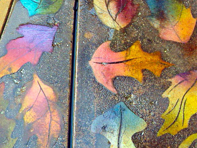 Multi-toned acrylic stained concrete leaves