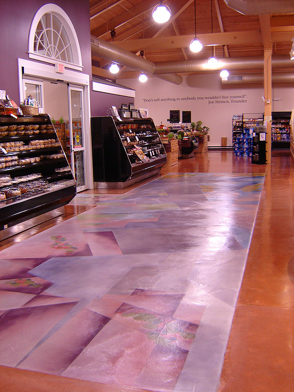 """Don't sell anything to anybody you wouldn't buy yourself"" Joe Heinen, Founder quote at grocery store with stained concrete floors."