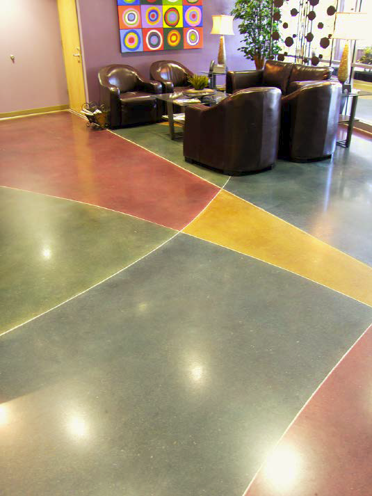Colored concrete floor that has distinct line differences engraved.