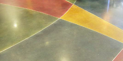 Colored concrete floor that shows vibrancy in this waiting room