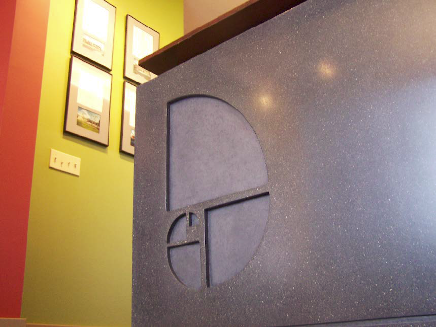 Concrete imprinted logo on side of counter