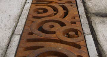 Designer Cast-iron Drain Covers from Iron Age Designs