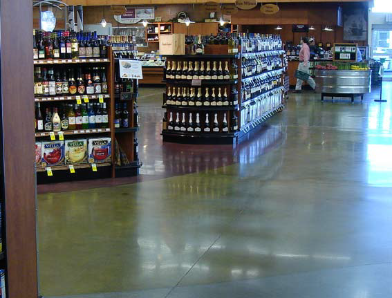 Polished concrete floor in a retail store near the wine and beer selections