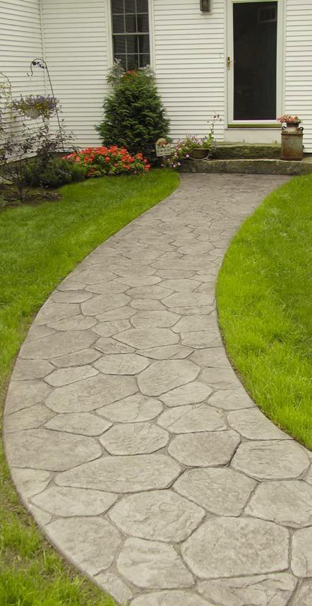Decorative concrete stamp in a cobblestone pattern makes for a great walkway.