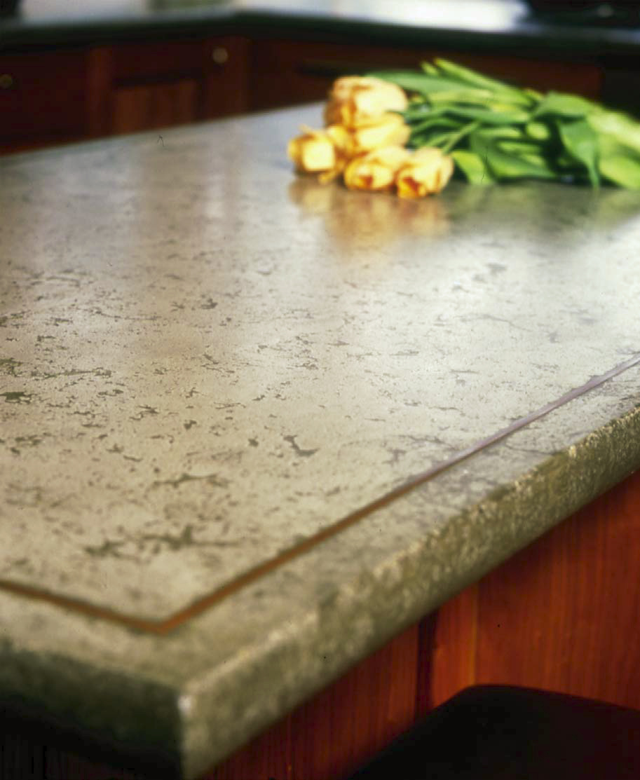 Concrete countertop edge with yellow roses.