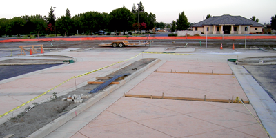 Integrally colored concrete in a commercial parking lot.