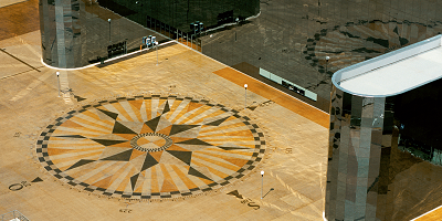 Stained concrete compass in the courtyard of an Arena Monterrey