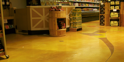 Decorative concrete work done at a 22,000-square-foot Heinen's Supermarket in the Cleveland area. Bonding primers were used to help concrete adhere to ceramic tile.