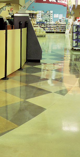 Stained concrete floor in a geometric pattern in a grocery store.