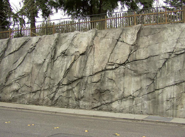 Large natural stone looking retaining wall made of concrete.