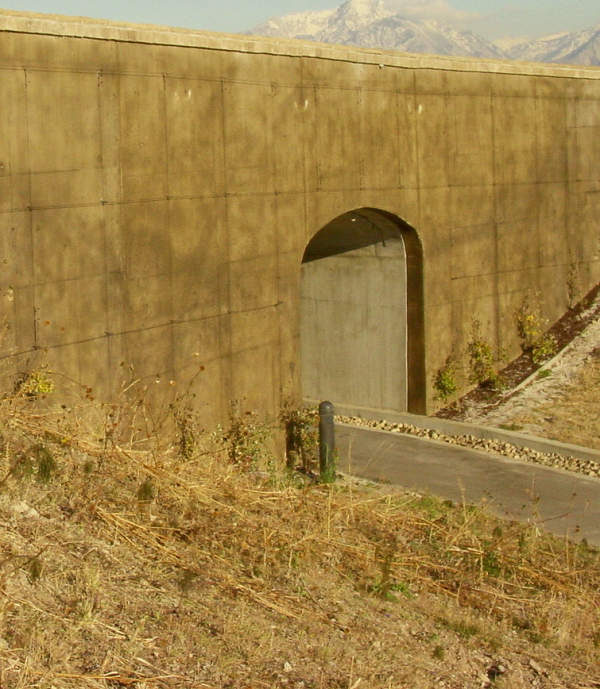 A retaining wall that also includes a tunnel within the middle.