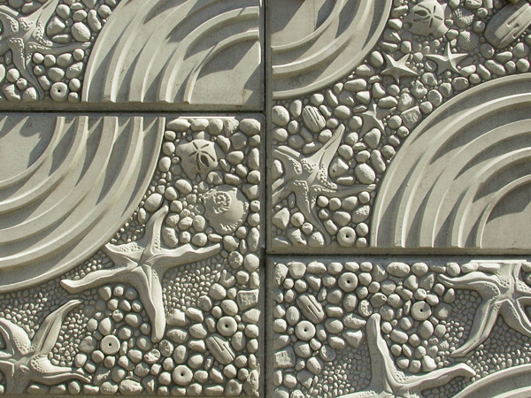 Starfish and stones create this unique artistic retaining wall.