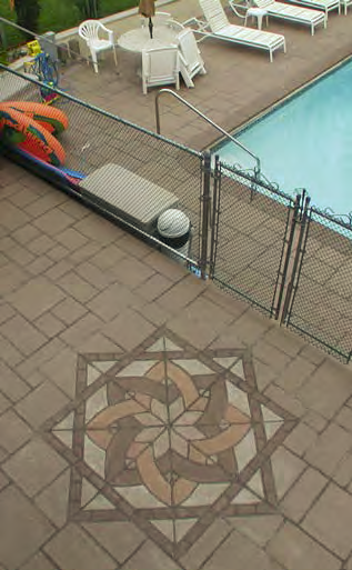 A geometic pattern at the entrance of this pool fence.