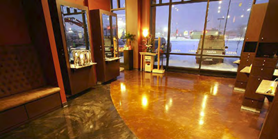 A stained concrete floor in a high-traffic area can be affected by inclement weather, even indoors.
