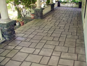 A resurfaced concrete deck with stamped concrete and stain.
