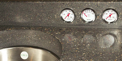 "Unique concrete countertop with gauges to create a ""pit stop"" look."