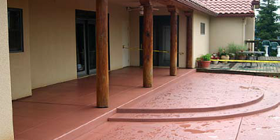 Concrete patio sealed with two coats combining color and sealer.