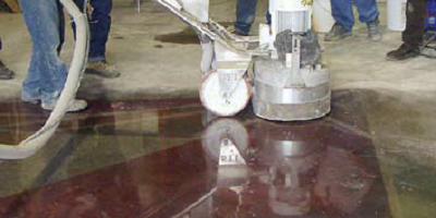 Running a polishing machine on some dyed concrete.