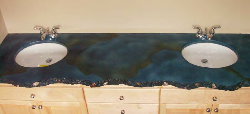 This concrete countertop in the master bathroom features exposed shells highlighted with paint.