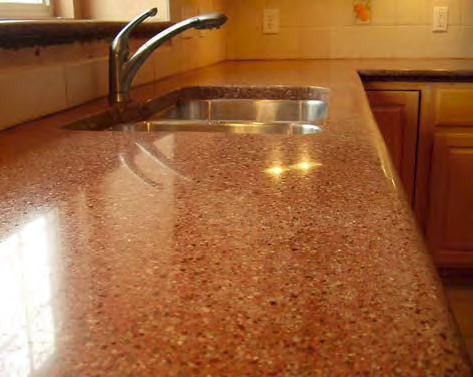An orange concrete countertop with clean lines and a smooth finish.