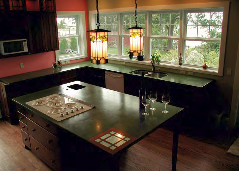 A green countertopped kitchen makes a very nice aesthetic in this natural kitchen.