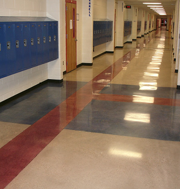 Polished and colored concrete in a school hallway.