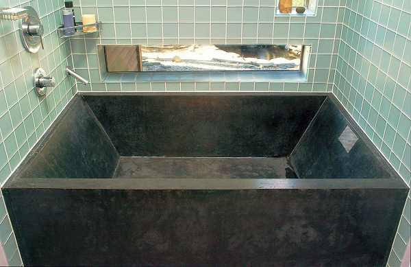 Stone Soup Concrete created this black tub from five tongue and groove pieces. It weighs 1,750 pounds and has a 120-gallon capacity.