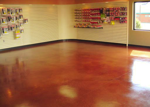 Concrete show room with orange stained concrete floor.