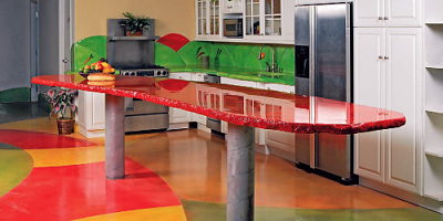 Glossy Red concrete Countertop in a bright kitchen. Stained concrete floors vibrant colors.