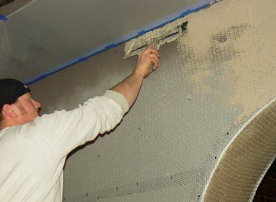 Ryan Siebol of KW Specialized Construction uses a flat trowel to apply a vertical application.