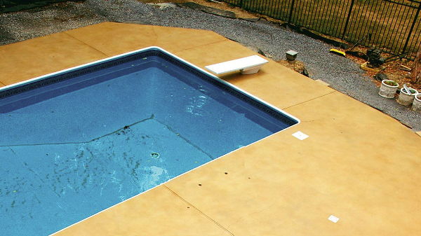 A pooldeck that has had stain applied to it.