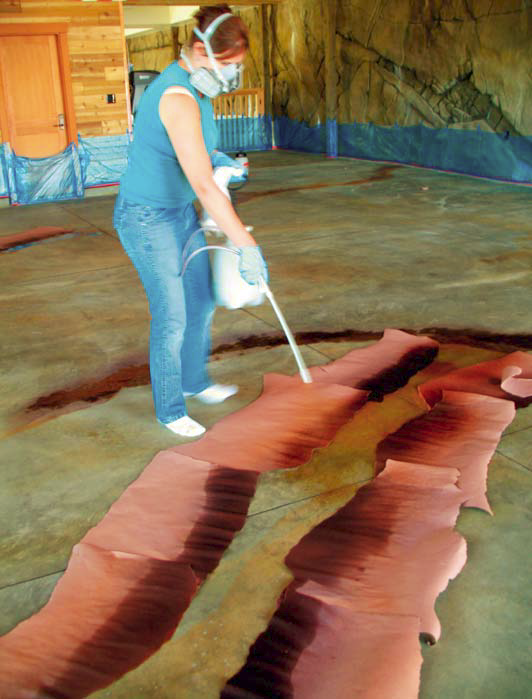 Additional dye strata. This worker is flashing with orange-brown dye to create two hard torn-paper edges.
