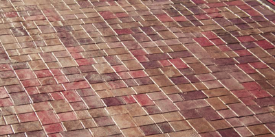 Look at the concrete overlay system that mimics a brick paver look.