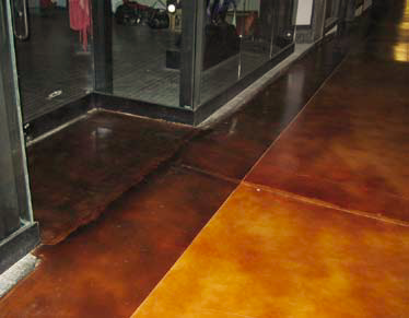 A closer look at the stained concrete border that provides clear delineation for the storefronts.