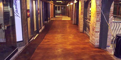Hallway in an historic building get made over with stained concrete.