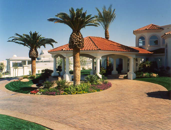 Spanish style home with a gazebo and stamped concrete bring this house into a high-end look.