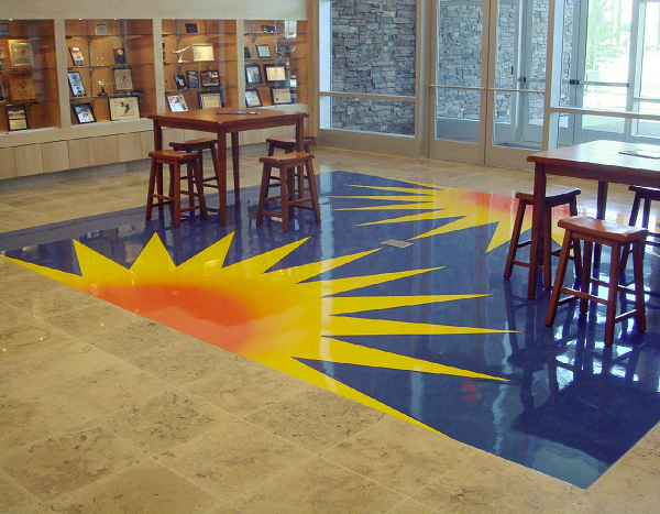 Concrete floor with vibrant sun design on a blue background