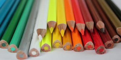 A pile of colored pencils representing adding color.