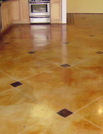 Acid stained concrete floor with darker smaller squares scattered throughout.