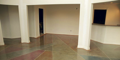Dyed and stained concrete in various triangular shapes with different colors.