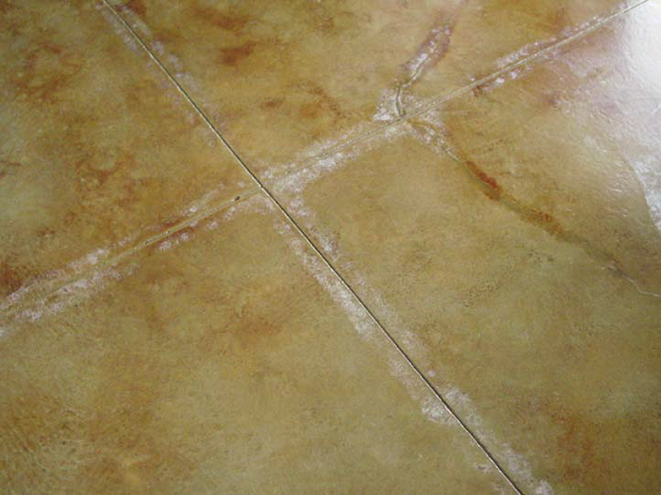 White discoloration is caused when a sealer is applied in temperaratures that are too cold.
