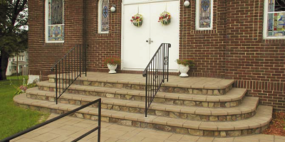 Steps leading into the church have been restored using a stone edge design.