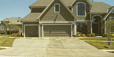A large home with a concrete driveway.