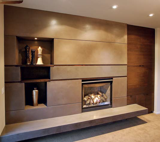Living room/dining room fireplace and coffee table: The double fireplace was one of the most challenging projects in the entire house. The dining room side is an artistic mixture of concrete, walnut columns and glass panels.